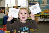 A Preschooler playing with certificates
