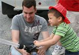 Firefighter interacting with Preschooler