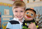Preschooler playing with a puppet