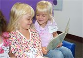 Two Preschoolers reading to each other